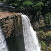 pan down zoom out Wailuaa falls
