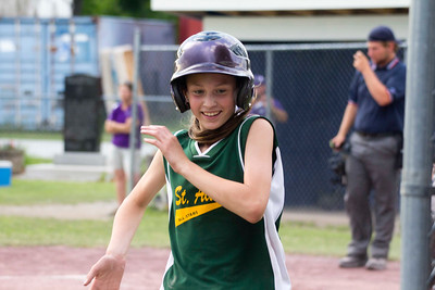 JOSH KAUFMANN, St. Albans Messenger Maddie Hungerford returns to the St. Albans dugout after scoring a run in Tuesday's 18-8 victory over Missisquoi in the 11-12-year-old Little League District 3 Softball Tournament in Swanton. St. Albans will face undefeated Essex tonight at 6, needing a win to force a rematch for the championship.