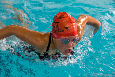 JOSH KAUFMANN, St. Albans Messenger Ashleah Adams of the Rutland Swim Team races in the 12-and-under 100-yard butterfly at Saturday's Vermont Swim Association state championships in White River Junction.