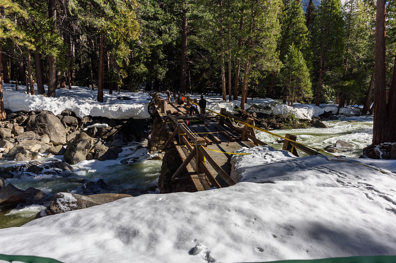 The Lower Falls Foot Bridge is under major repair ... damaged by water and ice.