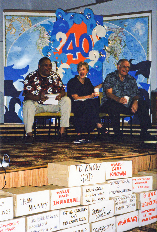 Frank Naea, Darlene and Loren laughing, at YWAM's 40th anniversary in New Zealand