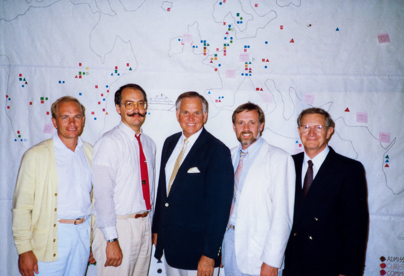 Lynn Green, Tom Bloomer, Loren, David Boyd, Howard Malmstadt in front of map.