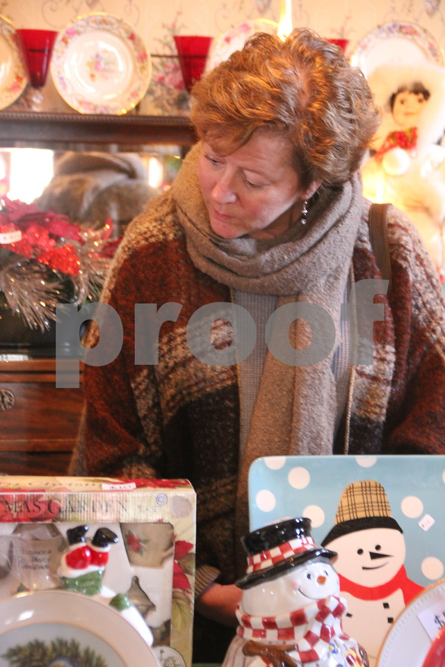 The YWCA Christmas Shoppe event was held at the Vincent House in Fort Dodge on Saturday, November 14, 2015. The event will come to a close on Sunday, November 15, 2015. Seen here is : Carol Dencklau as she looks over items for sale at the event.