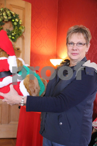 Seen here is : Deb Diemer with the Santa bear she  bought. The YWCA Christmas Shoppe event was held at the Vincent House in Fort Dodge on Saturday, November 14, 2015. The event will come to a close on Sunday, November 15, 2015.