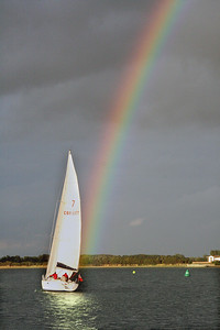 Yacht at the end of the rainbow