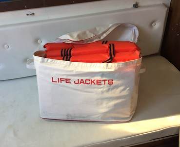 Life jackets x 4 . Never used. Also whistles and other safety gear