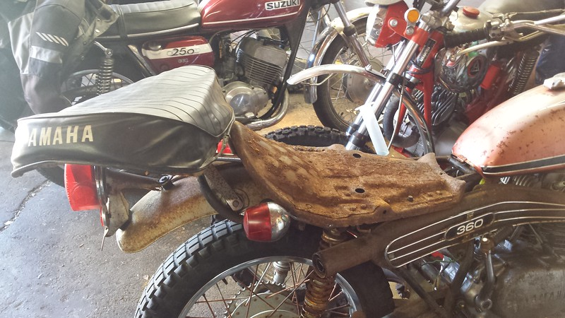 "Used seat cover and foam purchased from a ""Vintage Yamaha Enduro"" forum member."