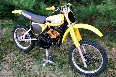 1978 YZ125E DG head reanodized and decked. NOS side plates never ridden on. The following parts are all NOS with 30 minutes break in time; cylinder,piston,rings,pipe,silencer,clutch case cover, clutch cable, front&rear fenders, airbox, air filter, shift shaft, shifter(no loose shifter on this bike),chain tensioner assembly,chain tensioner pad and rollers,brakes, wheel bearings, swingarm bearings, and bushings, swingarm pivot bolt. YZ250E rear shock rebuilt by Sage Suspension, with new shaft, seals,and 250E soft spring. 1980 YZ125G fork legs rebuilt with NOS seals and progressive springs,(36mm same diameter as 125E, but much better forks),front and rear suspension also 30 mins break in time only. This is the ultimate suspension package for the YZ125E. New front tire, rear tire has 1 ride on it, new Renthal vintage bars, new aluminum 51T rear sprocket, new gold DID chain, OEM rims, rear has one flat spot. Bottom end is from a 1977 YZ125D which is identical to 125E. Still has OEM stainless reed petals in mint condition. Tank is in great shape with very slight fade compared to NOS plastic, OEM clutch and brake perches, and throttle housing.