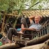 Bamboo raft pilot relaxing.