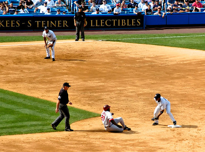 Vlad Guerro is out by quite a lot in this attempted steal of second base.  Jorge Posada, the Yankee catcher, gunned him down. Copyright 2006 by John M. Cerra