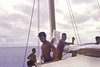 "Al:  ""The trimaran 'Tre Amori' in Woleai, en route to Chuuk, 1969.  The young man in the red thu is named Tilingabwat, meaning 'deaf,' which he was.  Great sense of humor and loved by all."""