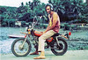 The Black Knight, alias Fred Smithberg, on motorbike, with Benjo Bay as a backdrop, around 1976