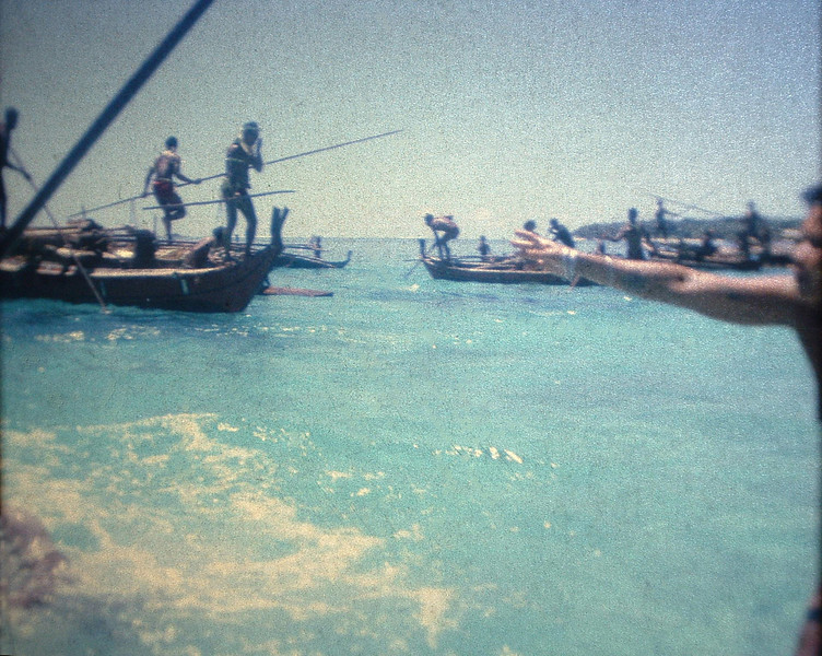 Rare site, old style fishing with spears, we had more fish in the Lagoon for weeks than we could save so wnt retro. Men wore white palm leaves so they would not be speared if they fell in. Yanesimal did in the near LBot. but is ok had on T-shirt. These 12-15' spears were kept in the canoe house for years without use. no lights on the island while fish were in the lagoon