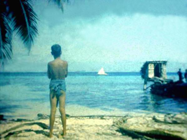 Ifalik Lagoon:  Boy, Boat, Benjo