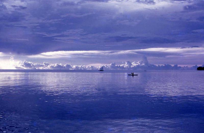 Canoes on the lagoon at twilight