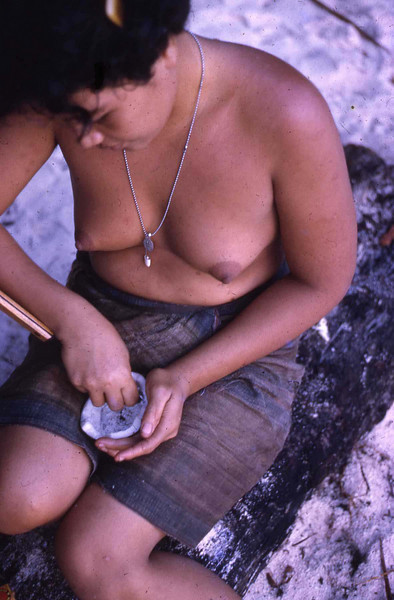 "Susan:  ""On Ifalik, Rita scraping coconut meat for soap."""