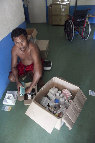 Cyril checks shipment of meds