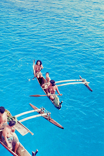 Canoes that, in the clear water of the lagoon, seem to float on air
