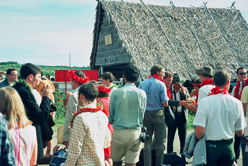 Micro 7 Peace Corps trainees arrival at the airstrip on Yap, summer of 1968; Art Hegewald, fifth from right, reaching for a coconut