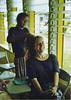 Training on Chuuk:  Girl braiding Leslie's (Peace Corps) hair