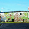 Mural (painted by the Art Class at Yap High School) on the side of the old Supply Building across from the YCA