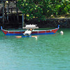 Canoe moored in Chamorro Bay