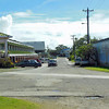 The large new Yap Cooperative Association (YCA) store and shopping center (on the left), with the old Supply Building across the street.