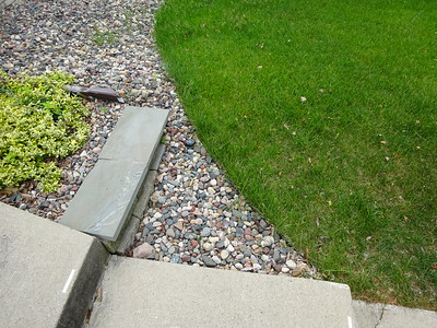 The old edging ended at the left of the top stone.  That left two square areas to be mowed by hand!
