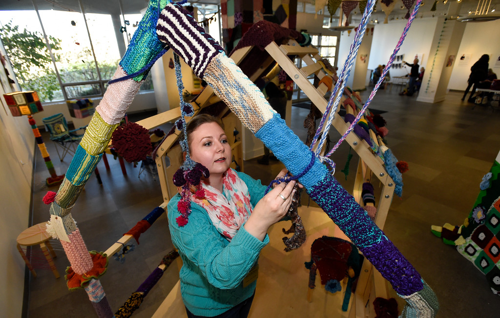 . BEST 1. BOULDER, CO - NOVEMBER 8, 2018: Library staff member Alicia Marian helps tie yarn decoration on a structure while setting up the Yarn-Fiti exhibit on Thursday inside the Boulder Public Library in Boulder. For more photos of the Yarn-Fiti exhibit and volunteers go to dailycamera.com (Photo by Jeremy Papasso/Staff Photographer)