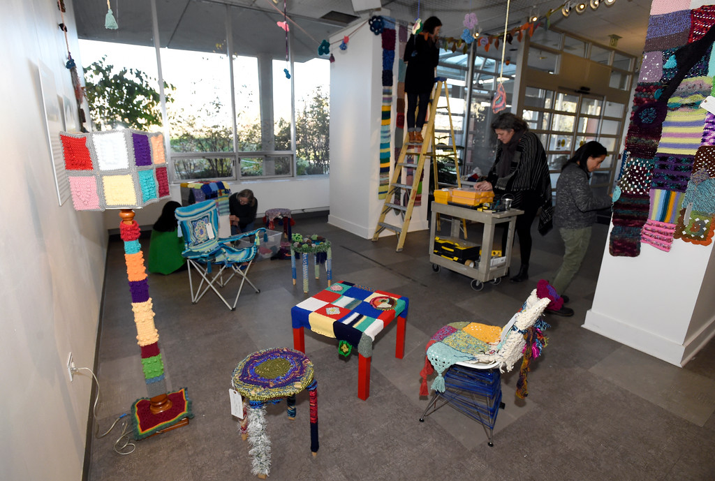 . BOULDER, CO - NOVEMBER 8, 2018: Volunteers set up the Yarn-Fiti exhibit on Thursday inside the Boulder Public Library in Boulder. For more photos of the Yarn-Fiti exhibit and volunteers go to dailycamera.com (Photo by Jeremy Papasso/Staff Photographer)