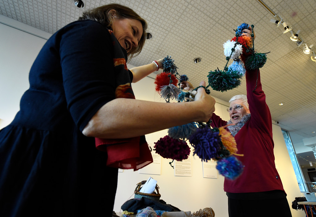 . BOULDER, CO - NOVEMBER 8, 2018: Louise Fordyce, left, and Judith Kremen work to set up the Yarn-Fiti exhibit on Thursday inside the Boulder Public Library in Boulder. For more photos of the Yarn-Fiti exhibit and volunteers go to dailycamera.com (Photo by Jeremy Papasso/Staff Photographer)