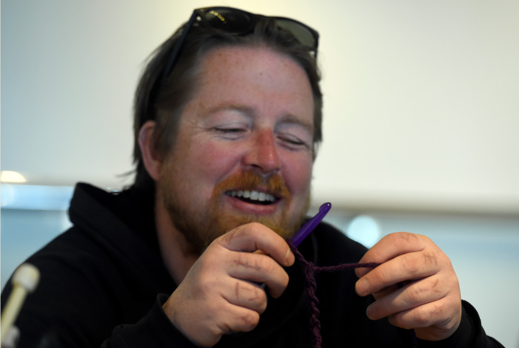 . BOULDER, CO - NOVEMBER 8, 2018: Patrick Holman crochets yarn while setting up the Yarn-Fiti exhibit on Thursday inside the Boulder Public Library in Boulder. For more photos of the Yarn-Fiti exhibit and volunteers go to dailycamera.com (Photo by Jeremy Papasso/Staff Photographer)