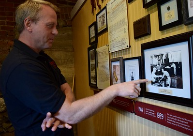 Mike Titus, co-owner of Yates Cider Mill, points to a historic photo on the wall at the mill, 1990 Avon Road in Rochester Hills on Thursday, May 10, 2017.