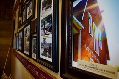 A wall of historic photographs at Yates Cider Mill, 1990 Avon Road in Rochester Hills on Thursday, May 10, 2017.