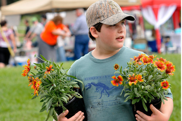 7 13 13 MD Bo Pasley carrying flowers for his mom, Becca Pasley