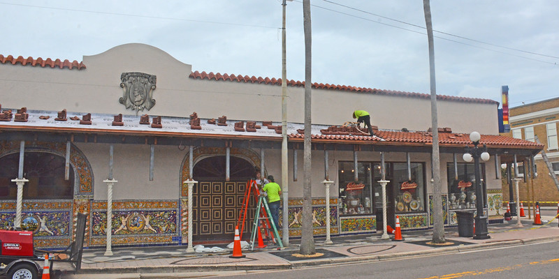 Workers doing some restoration work to the America's largest Spanish restaurant, the Columbia resturant,  with its exterior's  beautiful tilework.