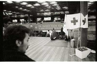 """The total irony. Red Cross on right side, the poster saying """"Under the flag of Big October to next wins of socialism""""."""