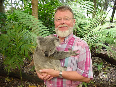 Steve hugging his Koala! Looks like the Koala is putting him to sleep. Lone Pine Koala Sanctuary