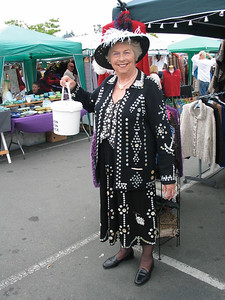 "Nelson Saturday Market. ""The Pearly Queen"".  She sewed 2,000 pearls and buttons, in the design of anchors on the sleeves and bunches of grapes on the skirt, and is collecting money for the Hospice."