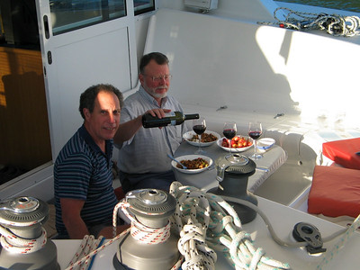 David and Steve dining at anchor in Umungata Bay, Queen Charlotte Sound, Marlborough Sounds, New Zealand
