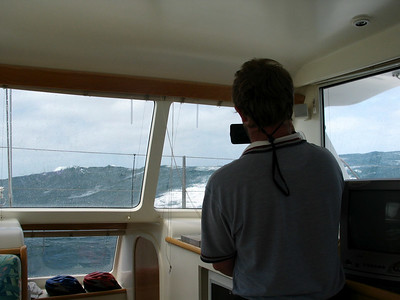 By 27 Nov, the seas are getting up. Pete watches the crest breaks through the starboard salon windows.