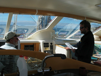 Steve and Peter Cook planning the passage as we depart Hobart for New Zealand.