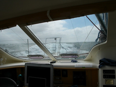 White wave tops crossing ahead of ADAGIO as the sky clears a bit