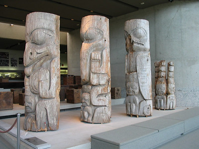 U of BC Museum of Anthropology -  150 year old totem pole that was sawed in four pieces; stack from right to left. Watchmen, eagle, cormorant, bear.