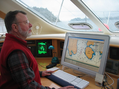Steve navigating us safely through the infamous Seymour Narrows, and over Ripple Rock, in the rain. Notice the radar image in green.