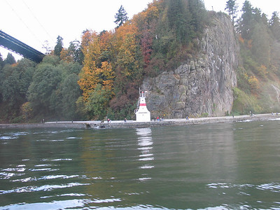 Entering Vancouver Harbour, Seawall Promenade and Prospect Point Light at Stanley Park, under Lion's Gate Bridge