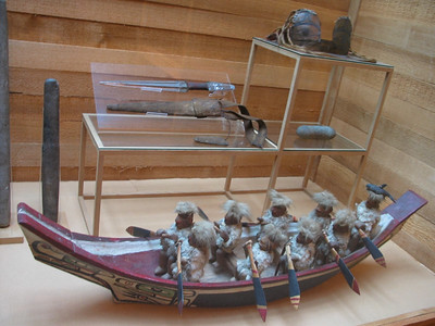 Old carving of warriors in cedar canoe at the Museum of Northern British Columbia, Prince Rupert