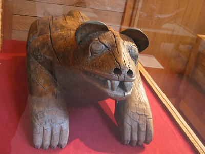 Old wood carving of bear at the Museum of Northern British Columbia, Prince Rupert