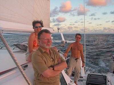 Enjoying the sunset while sailing from Bora Bora to Hawaii -- Vanessa, Steve and Callum