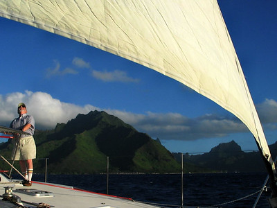 Departing Cook's Bay, Moorea -- Steve checks the set of the sails